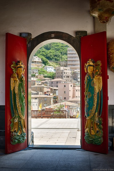 Looking out the door of Wulinggong Temple towards the (mostly) traditional fishing village of Nioujiao